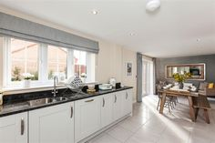 Stokesley Grange is a fabulous new development of 4 and 5 bedroom homes situated in the picturesque market town of Stokesley. Bright Kitchens, Grey Kitchens, Dining Area, Kitchen Dining, Taylor Wimpey, Study Rooms, Stair Storage, Room Dimensions, Big Houses