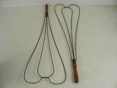 old vintage wire rug beaters with wood handles