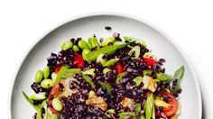 The pleasantly earthy flavor of black rice pairs well with the bright acidity of this salad's vinaigrette. If you can't find it, use wild rice instead.