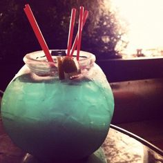 Green Fish Bowl Drink Recipe.  What do you need:  3 oz. Coconut Rum  3 oz. Blue Curacao  3 oz. Vodka  3 oz. Pineapple Juice  1/2 cup Sweet & Sour Mix  3 oz. Sprite  Lemons  Ice