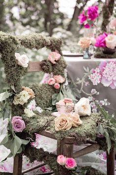 Unique wedding decor idea - a moss and rose covered chair. Not for sitting on (obviously) but as a pretty focal point.
