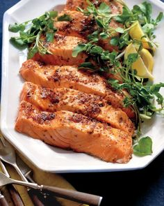 Salmon with Brown Sugar and Mustard Glaze (video included) 1 tablespoon extra-virgin olive oil 1 large shallot, minced 1/4 cup red-wine vinegar 1/4 cup whole-grain mustard 1/4 cup packed dark-brown sugar Coarse salt and ground pepper 1 side salmon (about 3 pounds), skin removed, cut into 8 fillets 1 bunch watercress (about 3/4 pound), thick stems trimmed 1 lemon, cut into wedges, for serving