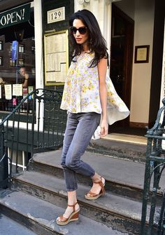 Amal Clooney wearing a Giambattista Valli top, Valentino wedges, Prada sunglasses and Dolce & Gabbana earrings on the streets of NYC.
