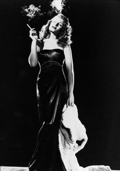 GILDA  In Gilda, Rita Hayworth performs a striptease in a black dress - and it became the most iconic example of a femme fatale in film.    FACT: The dress was created by American costume designer Jean Louis, who collaborated with Rita on nine films and was responsible for cultivating her glamorous image