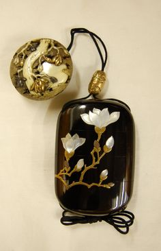 Inro (3 case). Magnolia blossoms and branches. Made of shell (white) inlaid and gold takamakie lacquer (black).