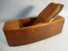 """Wooden Smoothing Plane, Hardwood, Coffin shaped. Owner/user name ( J. CARR-- 3 stamped on front end. Two & one quarter inch wide cutter is in good condition, showing normal use with minor peening. Blade is stamped....Ames Tool Co. -- Warranted... and is clean and free of rust. The plane is 8 1/2 """" long x 2 7/8"""" wide."""