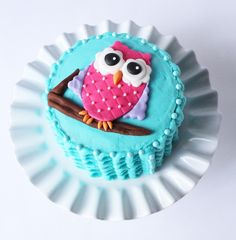 The tree branch is chocolate fondant. I gave the owl a quilted look by gently rolling the pizza cutter across the body and placing pink sugar pearls.