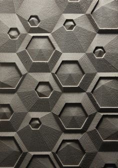 Part of a series of work proposing new architectural surfaces. This is a grid of nested hexagons with linework radiating from the center of each module.  It was designed, drawn and fabricated digitally.  The material is mdf milled with a CNC router.