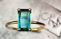 This stunning, emerald cut, green tourmaline would make a stunning engagement ring or glamorous everyday ring.    This tourmaline is VS in