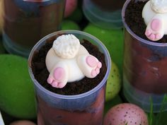 """Bunny diving in the dirt, bottom up.  GREAT Easter Party ideas here.  (Some have added green coconut """"grass"""" to the top )"""