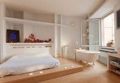 10 an airy Japandi bedroom with a free-standing bathtub by the window to enjoy the views - DigsDigs Loft Room, Bedroom Loft, Dream Bedroom, Bedroom Decor, Cozy Bedroom, Master Bedroom, Bedroom With Bathtub, Bathroom Renovation Cost, Open Plan Kitchen Living Room