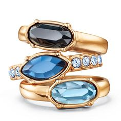 An enchanting collection of brilliant blue faux stones set in goldtone. Set of 3 stackable rings with faux stone in different shades of blue. Two are oval shaped stones and one is boat shaped with rhinestones on the band. Imported.