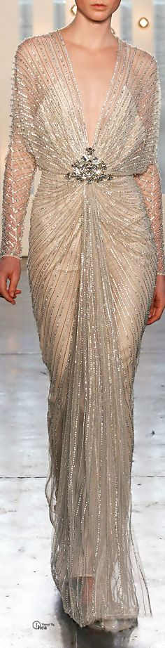 Jenny Packham Fall 2014. Wow, what a gorgeous ensemble! I simply can't get over the beauty behind that sparkle! The plunging neckline and over-sized sleeves are just darling. Let's not forget that statement piece = the pin!