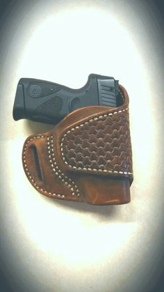 A nice basketweave holster by COCAJO for a compact Taurus