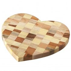 A beautiful patchwork of 6 different coloured woods (mango, papri, tune, Haldu, Babool and sheesham) make up this appealing, heart-shaped board. An attractive but practical addition to the table when you are entertaining, or a lovely item to use in your kitchen everyday. And you will be doing your bit for sustainability as the wood used comes from offcuts. This board has been fairly traded by Asha Handicrafts who have been practising Fair Trade since 1975, they ensure that the benefits of…