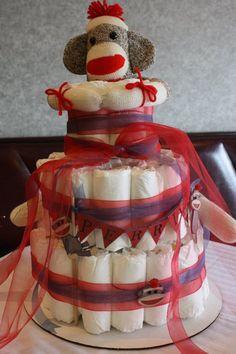 Sock monkey diaper cake for sock monkey themed baby shower. link to tutorial