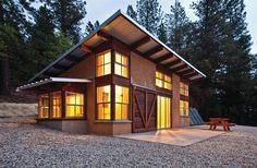 An energy-efficient, low-maintenance building shell and both passive and active solar energy systems yield a building that can fend for itself in a remote location subject to extreme weather.