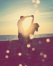 beautiful light in this photograph of a couple dancing on the beach. #photography
