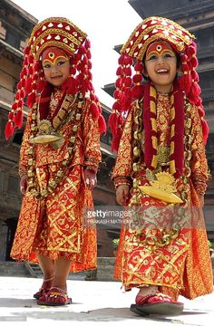Young Nepalese girls dressed in the outfit of a Kumari, the living goddess, pose during Kumari Puja rituals at Hanuman Dhoka in Durbar Square of Kathmandu on September 17, 2013. Some 504 girls under the age of nine from across the country have been brought to the temple for mass worship, protection from evil, and good luck in the future. Kumari, or Kumari Devi, is the tradition of worshiping young pre-pubescent girls as manifestations of the divine female energy or devi in Hindu religious…