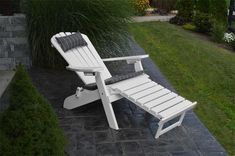 Folding and Reclining Poly Adirondack Chair with Pullout Ottoman The perfect spot to read or nap while you catch some rays! Made with durable poly, this Adirondack reclines. Pick fun cushions from a variety of colors. #adirondackchairs #outdoorchairs