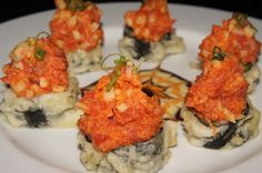 King Mountain Roll: king crab and asparagus inside. It is then fried and topped with spicy tuna.