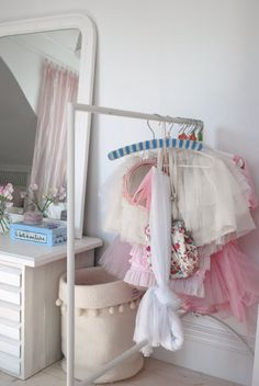 love the idea of having tutus and dress up clothes hanging out in a little girls room