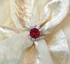 Ruby Ring or Engagement Ring Bypass Style With White Topaz in White Gold and Sterling Silver on Etsy, $299.00 This is the one I want future husband of mine
