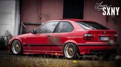 Brillantrot BMW E36 compact on OEM BMW Styling 5 wheels (BBS RC)