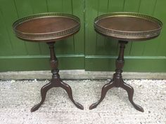 PAIR OF EARLY C20TH GEORGIAN STYLE MAHOGANY TRIPOD BASE TABLES WITH PIERCED BRASS GALLERYEDGE TOPS