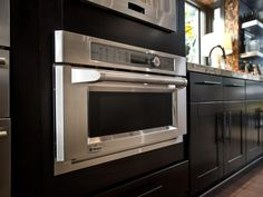 A built-in convection oven with speedcook technology offers the features of oven, microwave and warming drawer in one small appliance.  http://www.hgtv.com/dream-home/kitchen-pictures-from-hgtv-dream-home-2014/pictures/page-13.html?soc=pindhm
