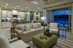 Gorgeous open floor plan with decor in cream and light green. See the Neal difference at our Design Gallery.