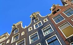 The narrowest house in Amsterdam: http://www.holland.com/global/tourism/cities-in-holland/amsterdam/amsterdam-secrets/the-narrowest-house-in-amsterdam.htm