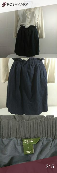 """J. Crew Linen/Cotton Mini Skirt Sz 4 Dark Blue Very good used condition. Shows minor color fading from normal use, . Sits at waist, falls above knee. Elastic waistband. On-seam pockets. Fully lined. 55% Linen, 45% Cotton. Lining 100% Cotton. Machine wash. Women's size 4. Color Dark Blue. Aprox. Laying flat measurements: 13.5"""" Waist (elastic), 17.5"""" Long. Discontinued design, no longer available at stores or website.  Other items on pictures not included, but may be available for sale on…"""