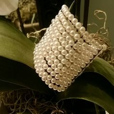 Beautiful Pearl cuff Gorgeous retro Pearl cuff measures 2 1/4 inches in width. Stretches to fit any wrist. EUC Boutique Jewelry Bracelets