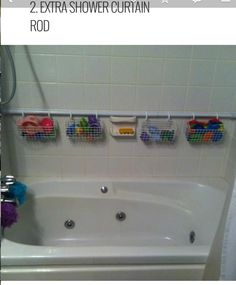 Shower curtain as holder for Raleigh's toys.  We need this. And will have it in our new house! Ah