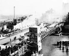 The richly decorated piers of the Michigan Avenue bridge were still under construction on its dedication day.