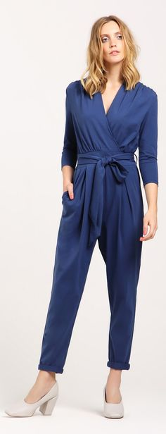 Peg Leg Wrap Jumpsuit with Tie Waist in Blue. Create a soft feminine silhouette at your next party with our peg-legged wrap jumpsuit. This summery jumpsuit features an adjustable belt and three-quarter length sleeves. Wear with heels for a classic evening style.  https://www.paisie.com/collections/new-in/products/peg-leg-wrap-jumpsuit-with-tie-waist-in-blue