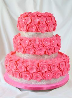 Fondant takes on a blushing shade of hot pink over a rich, moist chocolate cake iced in milk chocolate silk buttercream. And a little bling for the guest of honor!