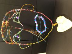 Self portraits out of wire...could be a fun summer art project!