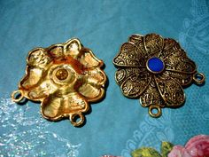 3 Antiqued Gold Flower Pendant Charms.  Supplies with a surprise