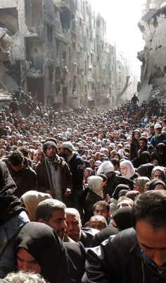 """War in Syria This isn't just """"War in Syria"""". This is the mass exodus of people from Yarmouk, a Palestinian refugee camp in Damascus that has been under siege by the Assad government and military since 2013. Yarmouk, where ISIS is now trying to make theirs. That is the victim of barrel bombs launched by a brutal regime. Fuck you and your war porn. Taking a picture of thousands of people fleeing their homes and haphazardly describing it as """"war in Syria"""""""