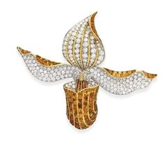 A SUPERB DIAMOND AND CITRINE ORCHID BROOCH, BY RENE BOIVIN