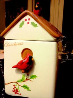 "A precious Red, Cream, Green and Brown ceramic cookie jar, bird house with lovely red cardinals. There is a little ceramic cardinal perched on the roof and one sitting outside the bird house door. Very traditional, classic and fine. A Winter Holiday, Christmas Classic. What would we do without our wonderful red cardinals!?  Merry Christmas!  Measures 6.5"" X 6.5"" X 12""   Happy Shopping from HSOnsale! (Don't forget to feed the birds this winter!"