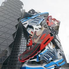 Deconstructive Style Sneakers Building Designed By Chris LaBrooy  Extruded Sneaker mash up rendered in glass, steel, concrete and wood.