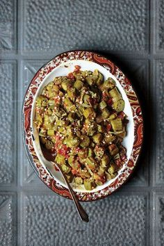 FROM ISSUE #168 Okra is a prized ingredient in Louisiana, particularly for gumbo, where it lends an earthy flavor and serves as a natural thickening agent. Since the fuzzy green pod's growing season is limited to the spring through the fall, resourceful home cooks preserve the vegetable in a variety of ways. Tina Hensgens, who works at the Falcon Rice Mill in Crowley, Louisiana, smothers her freshly picked okra with tomatoes in the summer, and freezes large batches of it so she and her…