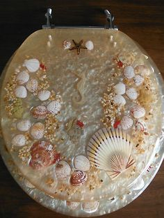 sea shell toilet seat. Seriously  what is not to love about this Another cool lucite and sea shell Toilet SeatsSea Google Image Result for http s8 thisnext com media
