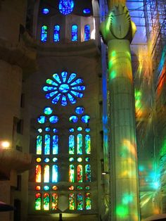 Interior view of the Cathedral Sagrada Familia in Barcelona with sunlight playing in the stained glass. Wikimedia Commons photo by Jordi Domènech, shared under Creative Commons license, details @ http://creativecommons.org/licenses/by-sa/3.0/deed.en