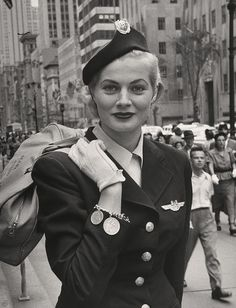 "sharontates: "" Miss Sweden Anita Ekberg, aged wearing a hostess uniform for Scandinavian Airlines during her hat-buying spree while visiting the US for possible work as a model, Photo by Lisa Larsen "" Anita Ekberg, Marcello Mastroianni, Pin Up, Jacqueline De Ribes, Mississippi, Photos Rares, Airline Uniforms, Portrait Studio, Flight Attendant Life"
