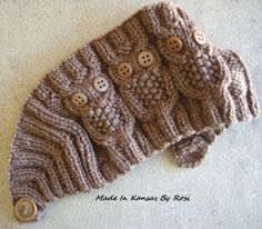 Three little owls, with button eyes... and a single button at the back secures this headband/earwarmer from Made In Kansas By Rosi... on facebook.