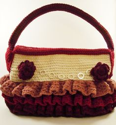 Maroon crocheted purse with silver accents and flowers. All handmade, inside and out. Check me out on Etsy at https://www.etsy.com/shop/ThePurplePalace.